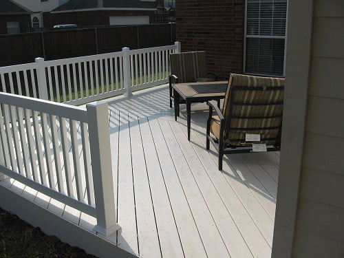 Vinyl decking with rail